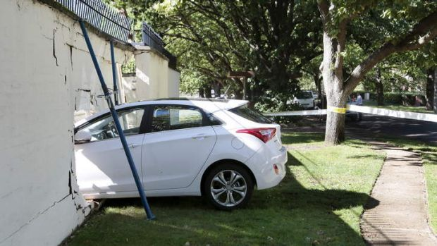 The car lodged in the wall of the Lodge in Canberra after a collision on Saturday morning.