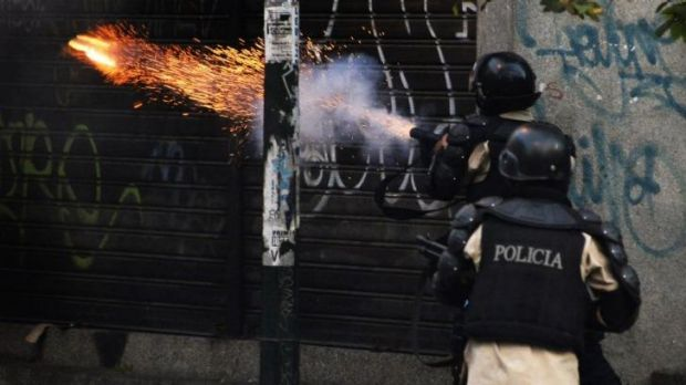 Riot policemen shoot tear gas during a protest against Venezuelan President Nicolas Maduro.