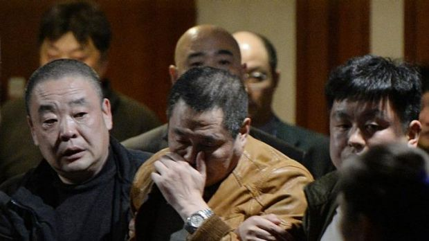 Grieving Chinese relatives of passengers on the missing Malaysia Airlines flight MH370 leave after being told of their ...