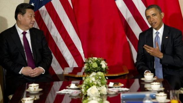 US President Barack Obama speaks with Chinese President Xi Jinping during a meeting at the US ambassador's residence in ...
