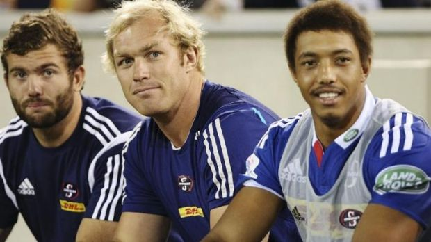 Sidelined: Schalk Burger (C) in Canberra on Saturday night.