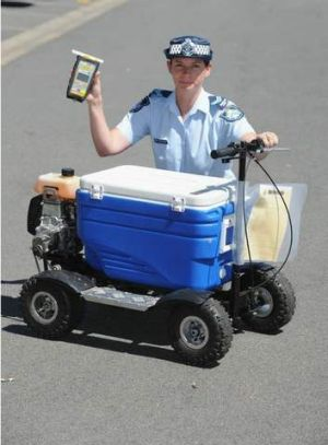 Senior Constable Kelly Miles with a motorised esky that a man was allegedly riding in public while over the limit.