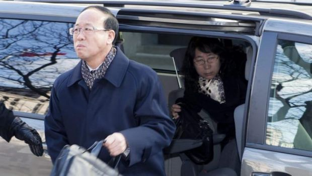 Liu Qian's father Liu Jianhui and mother Zheng Yaru,  arrive at court for the trial of Brian Dickson.