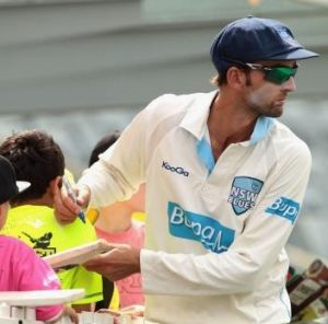 Nathan Lyon signs autographs during the Sheffield Shield final.