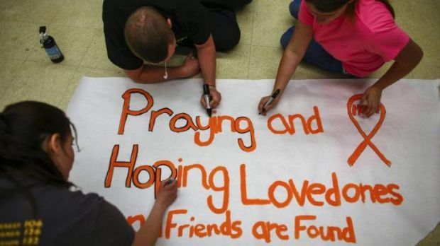Darrington High School students make posters following the deadly mudslide.