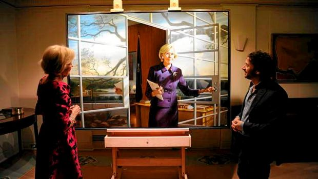 From both sides: Quentin Bryce views the official portrait of her by artist Ralph Heimans.