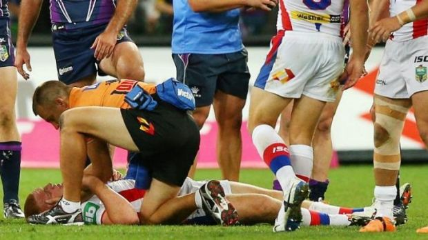 Alex McKinnon receiving medical attention after suffering the injury.
