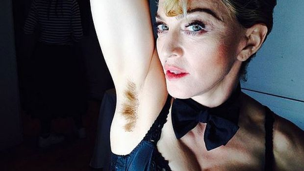 "Last week Madonna posted this picture on Instagram with the caption ""Long hair…… Don't care!!!!!! #artforfreedom ..."