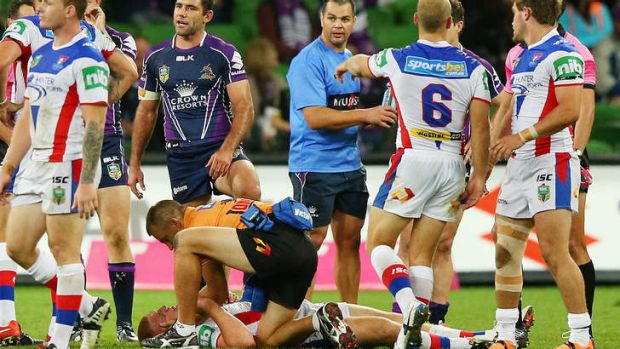 Alex McKinnon lays on the ground after being tackled.