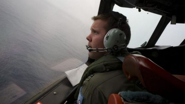 An RAAF Orion on a low-level search for the missing Malaysia Airlines plane.