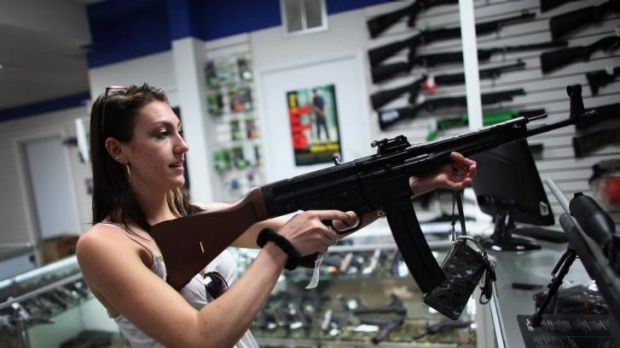 A woman looks at guns on sale in April 2013 at the National Armory gun store in Pompano Beach, Florida.