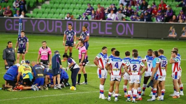 Grim viewing: McKinnon was treated on the field for five minutes in Melbourne on Monday night as his teammates looked ...