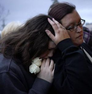 A town in mourning: A candlelight vigil for the mudslide victims.