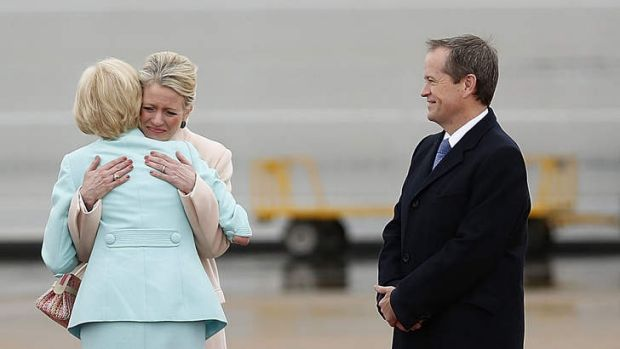 Mum's the word: Opposition Leader Bill Shorten watches on as his wife Chloe hugs her mother, Governor-General Dame ...