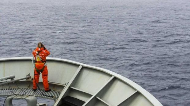 Still looking for the debris ... A lookout on bow of HMAS Success during the search in the southern Indian Ocean for ...