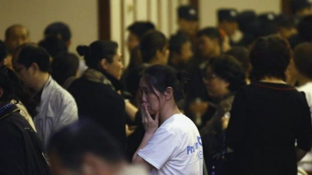 A relative of a passenger aboard Malaysia Airlines MH370 reacts as she leaves a room after a briefing by the Malaysian ...