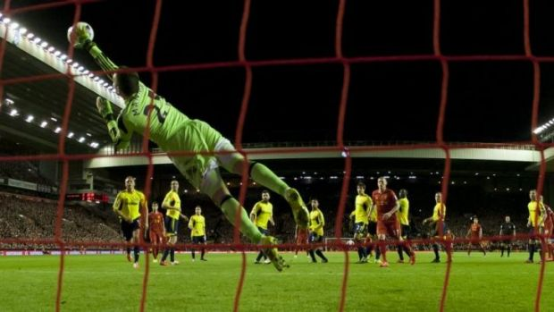 Sunderland's goalkeeper Vito Mannone dives in vain to save a free kick from Liverpool's Steven Gerrard.