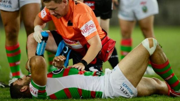Out: Souths star Greg Inglis was knocked out in the opening minutes of the game against Wests Tigers and spent the rest ...