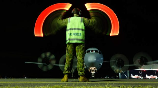 Rough ride: An Orion returns to RAAF base Pearce from its search over the southern Indian Ocean.