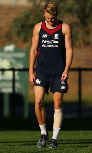 Jack Watts wears a compression bandage during a training session.