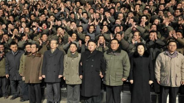 Not a single bourgeois ponytail in sight ...North Korean leader Kim Jong Un poses for a photo with some of his followers.