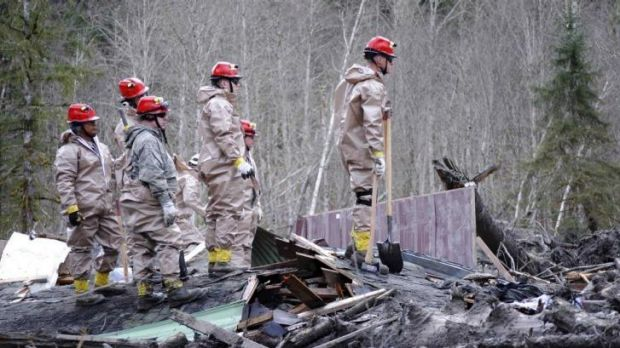 Air Force personnel join civilian workers in efforts to find missing persons following a deadly mudslide in Oso, Washington.
