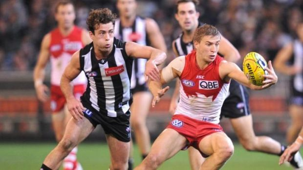 Sydney's Kieren Jack and Collingwood's Jarryd Blair in action in 2013.