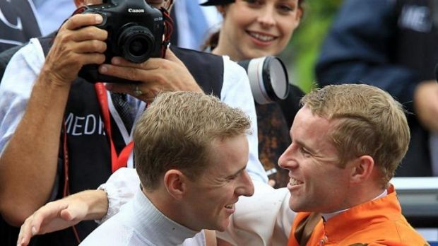 Brothers in arms: Nathan and Tommy Berry celebrate the latter's Golden Slipper win on Overreach last year.