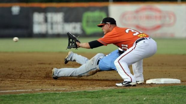 Slipped: Weston Creek Indians coach Jason Sloan is in doubt for the ACT baseball preliminary final after landing on a ...
