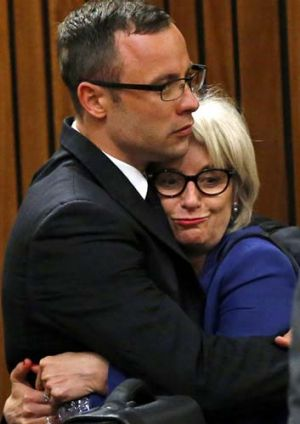 Drama: Oscar Pistorius and his aunt Lois after the prosecution closed its case.