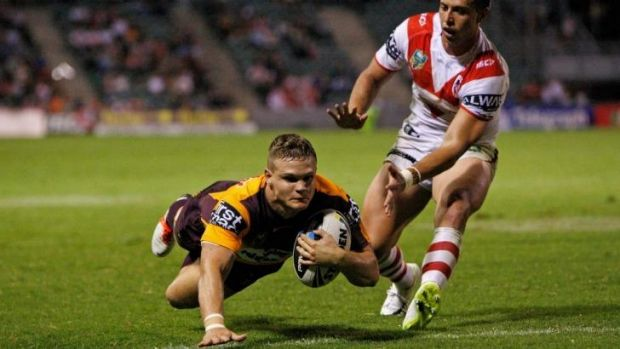 Try time: Dale Copley dives over for the Broncos to snuff out the Dragons' comeback.