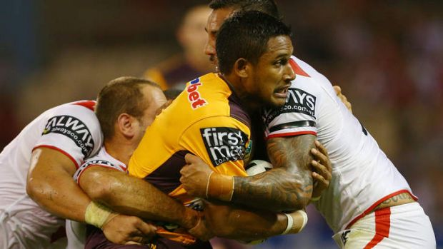Ben Barba of the Broncos is tacked by Dylan Farrell and Jason Nightingale.