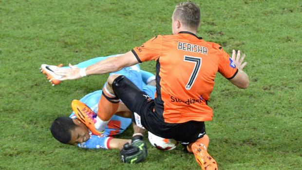 Besart Berisha of the Roar is given a red card by referee Chris Beath for this challenge on Robbie Wielaert of the Heart.