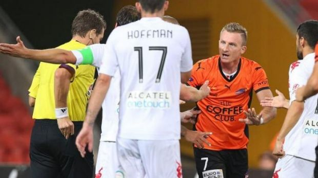 Referee Chris Beath reaches for a red card.