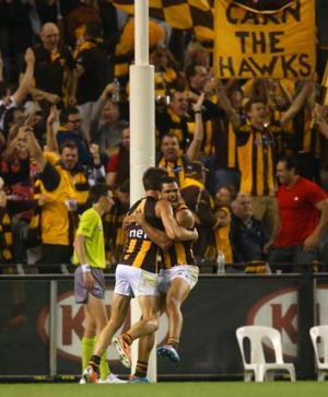 Cyril Rioli celebrates his match-winning goal.