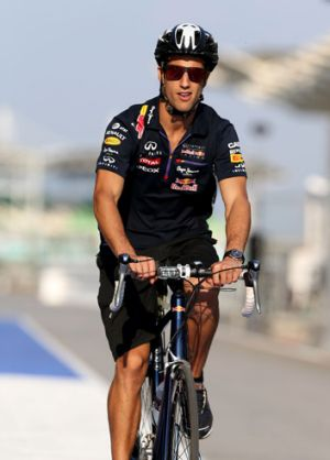 Life in the slow lane: Australian Daniel Ricciardo rides his bicycle in pit lane at the Sepang Circuit in Kuala Lumpur