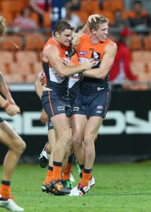 Youth and experience: Heath Shaw celebrates a goal with young gun Sam Frost.