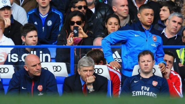 Tough viewing: Arsene Wenger watches on as Arsenal concedes six goals to Chelsea.