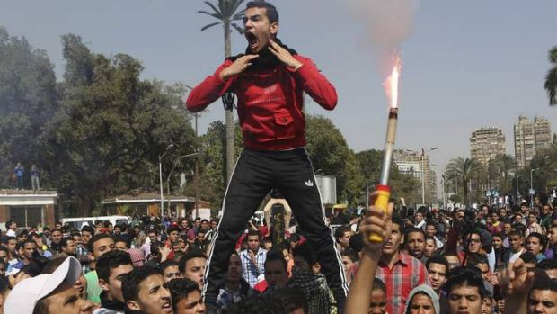 Muslim Brotherhood students and supporters of ousted president Mohamed Mursi pictured during clashes with riot police at ...