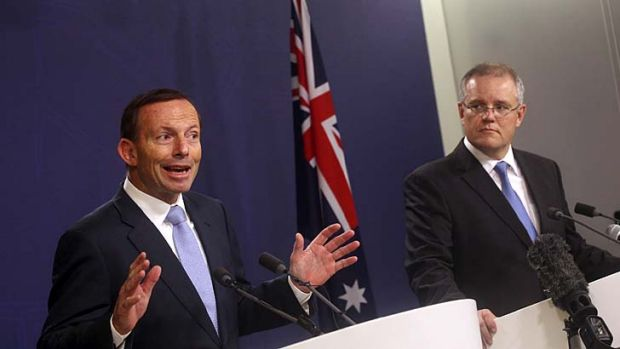 """It can be done"": Tony Abbott with Immigration Minister Scott Morrison."