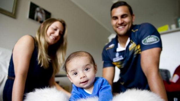 Jordan Smiler, with partner Stacey, can't wait to kick a footy with son Keanu.