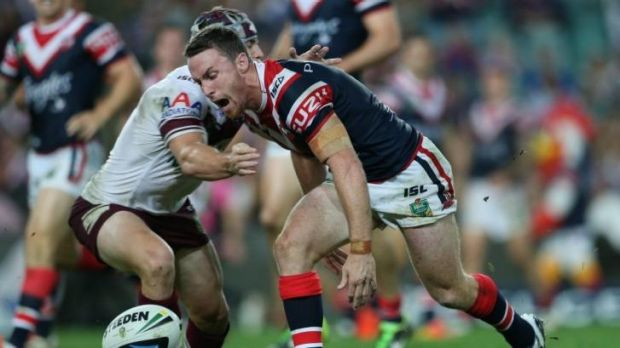 Setback: Roosters five-eighth James Maloney  yells as the ball slips from his hands against Manly.