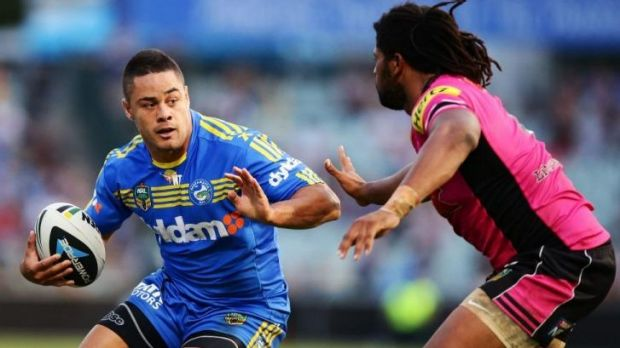 Parramatta co-captain Jarryd Hayne takes on Panthers centre Jamal Idris at Pirtek Stadium on Saturday night.