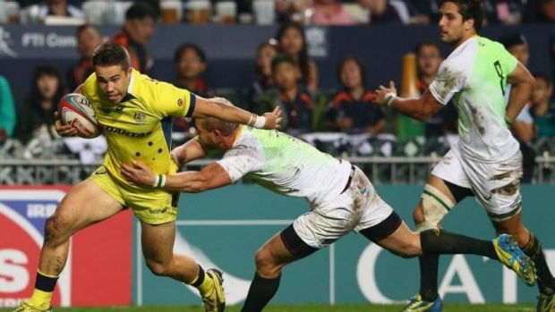Nabbed: Greg Jeloudev of Australia is tackled by a South African defender.