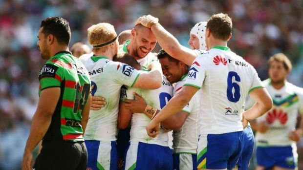 Try time: Raiders players congratulate Dane Tilse after he scored one of the team's five tries against South Sydney on ...