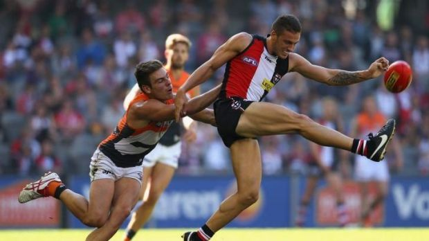 Tight contest: Stephen Coniglio of the Giants tackles Nathan Wright of the Saints at Etihad Stadium on Saturday.