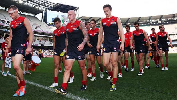 A familiar sight: Daniel Cross, Nathan Jones and Jack Grimes of the Demons lead the team back to the rooms after a big ...
