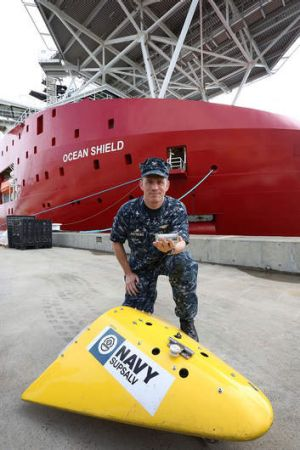 US Navy Captain Mark Matthews with an Acoustic Pinger with a Towed Pinger Locater in front of ADV Ocean Shield at HMAS ...