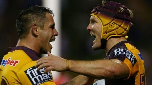 Buzzing Broncos: Todd Lowrie celebrates with Corey Parker (left) after scoring against the Dragons on Friday night.