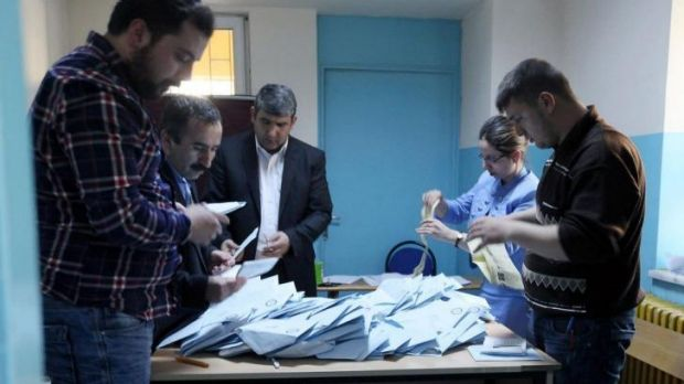 Electoral officers count votes at a polling station in Ankara.